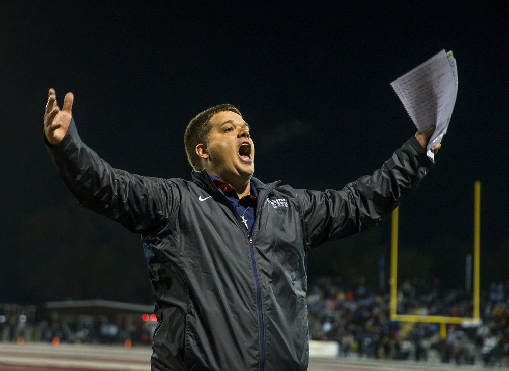 Rochester head coach Derek Leonard screams out to the crowd after the Rockets scored a touchdown on the first play of the game against Belleville Althoff in the first half of a IHSA Class 4A quarterfinal playoff game at Lindenwood Stadium, Saturday, Nov. 12, 2016, in Belleville, Ill. Justin L. Fowler/The State Journal-Register