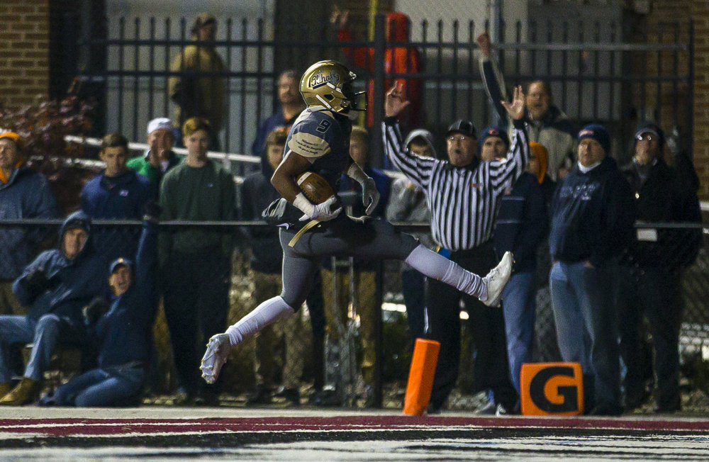 Belleville Althoff's Jaylon Bester (9) goes in for a touchdown against Rochester in the first half of a IHSA Class 4A quarterfinal playoff game at Lindenwood Stadium, Saturday, Nov. 12, 2016, in Belleville, Ill. Justin L. Fowler/The State Journal-Register