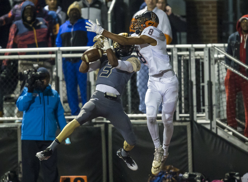 Belleville Althoff's Edwyn Brown (3) breaks up a pass intended from Rochester's Collin Stallworth (8) in the second half of a IHSA Class 4A quarterfinal playoff game at Lindenwood Stadium, Saturday, Nov. 12, 2016, in Belleville, Ill. Justin L. Fowler/The State Journal-Register