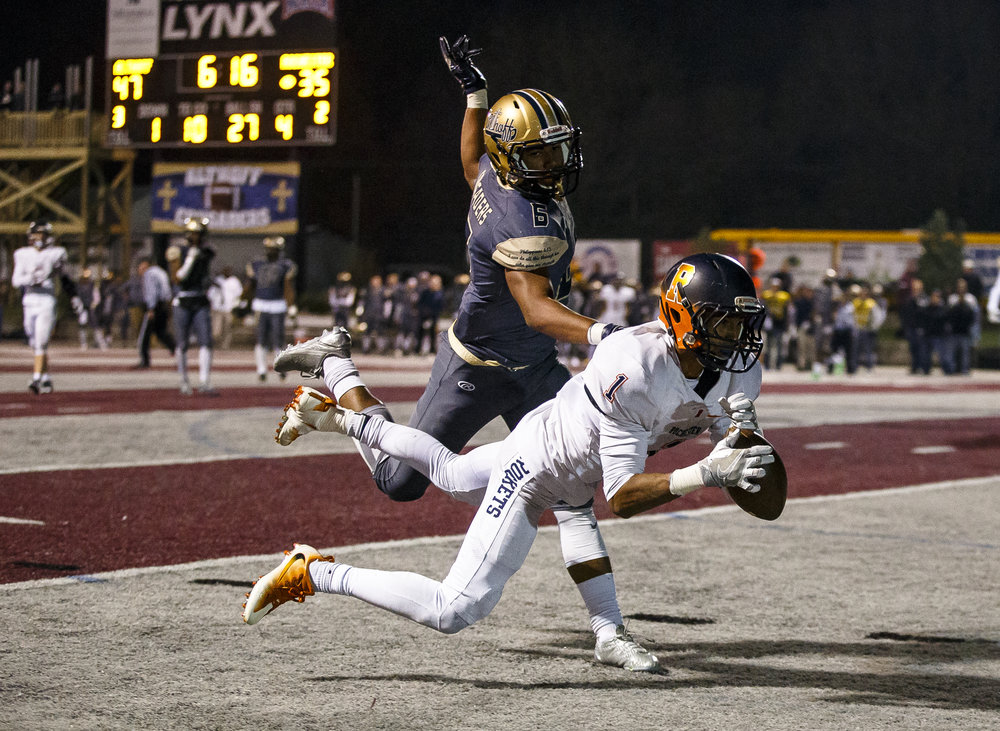 Rochester's D'Ante Cox (1) makes a diving catch for a touchdown against Belleville Althoff's Justin Strong (6) to make it 47-41 Belleville Althoff in the second half of a IHSA Class 4A quarterfinal playoff game at Lindenwood Stadium, Saturday, Nov. 12, 2016, in Belleville, Ill. Justin L. Fowler/The State Journal-Register
