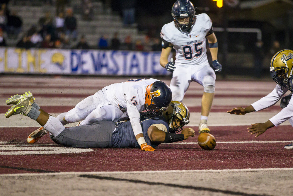 Rochester's Ben Chapman (17) and Belleville Althoff's Christian Wills (44) dive for the ball on an onside kick that is recovered by Rochester in the second half of a IHSA Class 4A quarterfinal playoff game at Lindenwood Stadium, Saturday, Nov. 12, 2016, in Belleville, Ill. Justin L. Fowler/The State Journal-Register