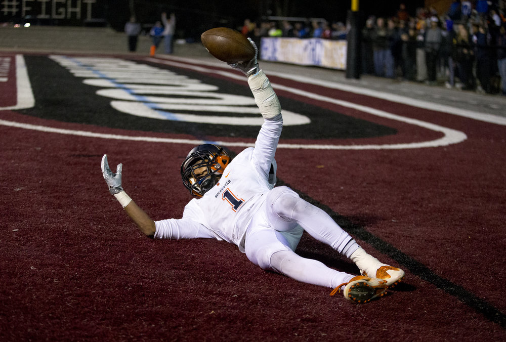 Rochester's D'Ante Cox (1) looks back for the touchdown signal after leaping out for a catch against Belleville Althoff in the second half of a IHSA Class 4A quarterfinal playoff game at Lindenwood Stadium, Saturday, Nov. 12, 2016, in Belleville, Ill. Justin L. Fowler/The State Journal-Register