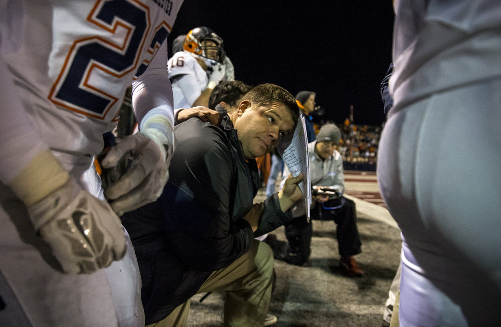 Rochester head coach Derek Leonard can't look as the Rockets tried to hold Belleville Althoff in the closing seconds of the IHSA Class 4A quarterfinal playoff game at Lindenwood Stadium, Saturday, Nov. 12, 2016, in Belleville, Ill. Justin L. Fowler/The State Journal-Register