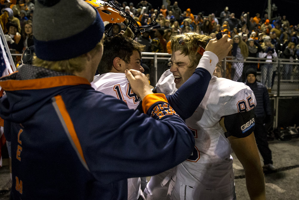 Rochester's Mike McNicholas (85) and Rochester's Josh Grant (14) celebrate the Rockets victory over Belleville Althoff in the IHSA Class 4A quarterfinal playoff game at Lindenwood Stadium, Saturday, Nov. 12, 2016, in Belleville, Ill. Justin L. Fowler/The State Journal-Register