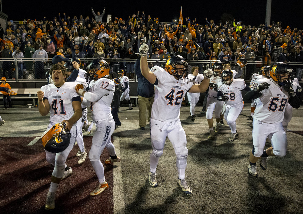 Rochester's Sam Baker (42) and the Rockets celebrate their 48-47 victory over Belleville Althoff in the IHSA Class 4A quarterfinal playoff game at Lindenwood Stadium, Saturday, Nov. 12, 2016, in Belleville, Ill. Justin L. Fowler/The State Journal-Register