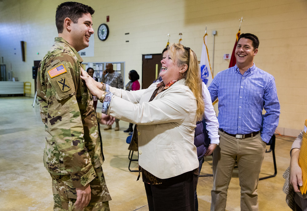 Jennifer McLennand laughs as she adjusts her son, Illinois Army National Guard Captain Chris McLennand's name tag following a deployment ceremony for members of the Illinois Army National Guard Bilateral Embedded Support Team -A18 at Camp Lincoln Thursday, Nov. 10, 2016. Ted Schurter/The State Journal-Register
