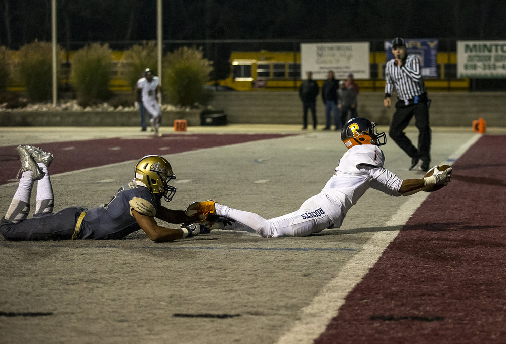 Rochester's D'Ante Cox (1) dives for the end zone to score a touchdown to put Rochester in the lead against Belleville Althoff's Justin Strong (6) in the second half of a IHSA Class 4A quarterfinal playoff game at Lindenwood Stadium, Saturday, Nov. 12, 2016, in Belleville, Ill. Justin L. Fowler/The State Journal-Register