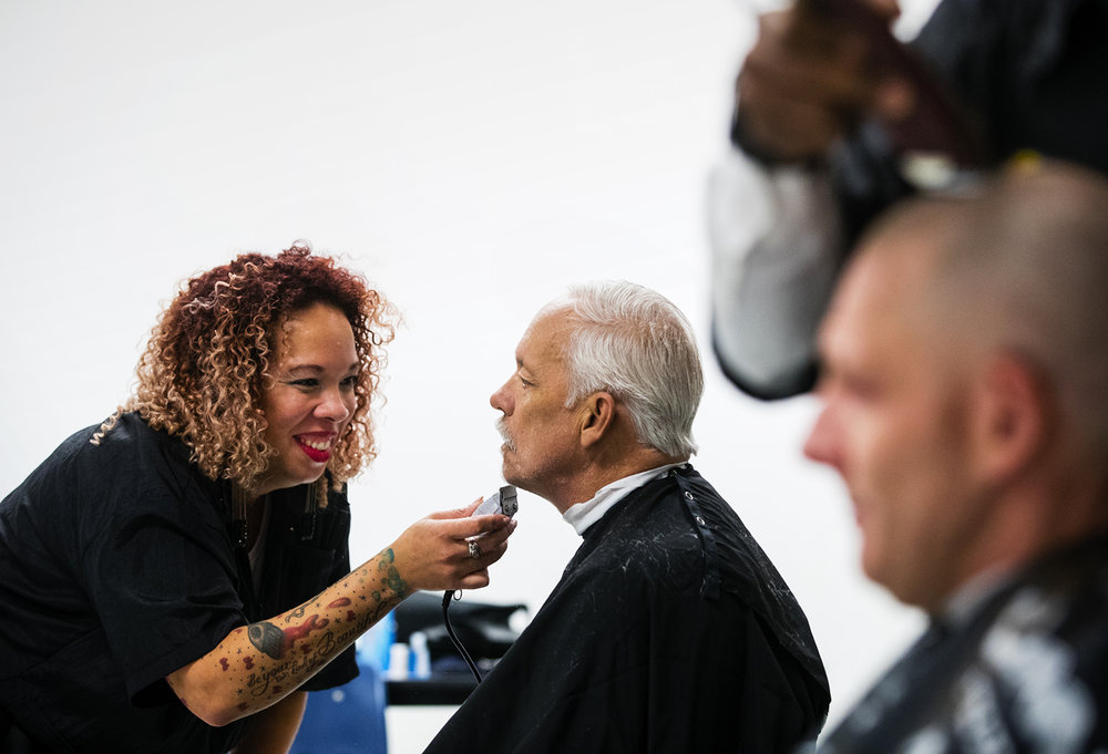 Tami Klein of the University of Spa and Cosmetology Arts in Springfield cuts Navy veteran Don Strode's beard during a Veterans Resource event sponsored by the Sangamon County Veterans Assistance Commission event at the Veterans of Foreign Wars Post 10302 Thursday, Nov. 10, 2016. Ted Schurter/The State Journal-Register