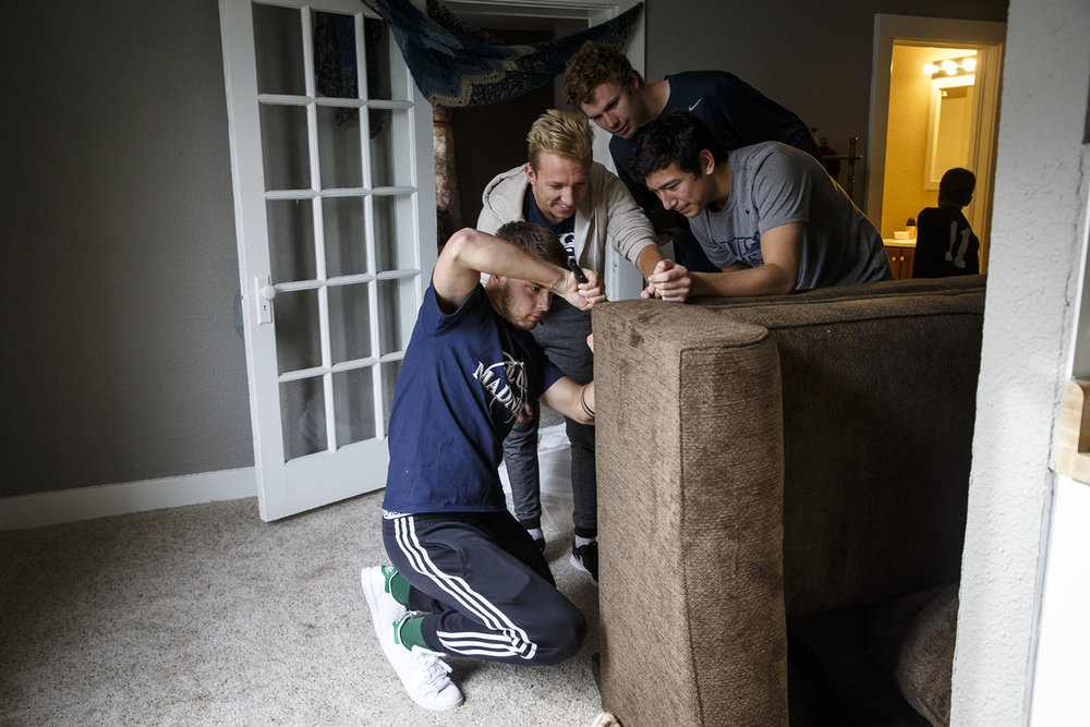 "University of Illinois Springfield soccer players Zach Downing, left, tries to get the leg of a couch installed with the help of fellow teammates Mario Falsone, center, Ryley Flynn and Kyle Bugay, right, as they volunteered their time to unload new furniture for the ""Our Home A Place for Veterans"" apartment building on South Douglas Avenue, Friday, Nov. 11, 2016, in Springfield, Ill. Five veterans received new furniture for their apartments through the Salvation ArmyÕs Supportive Services for Veterans and Family and was purchased with a grant from the Illinois Department of Veterans' Affairs. Justin L. Fowler/The State Journal-Register"
