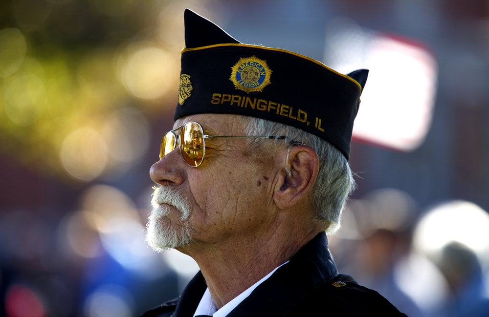 Jim Durkin, a member of the Inter-Veterans Burial Detail of Sangamon County, stands at parade rest during the annual Veterans Day ceremony at Camp Butler National Cemetery Friday, Nov. 11, 2016. Rich Saal/The State Journal-Register