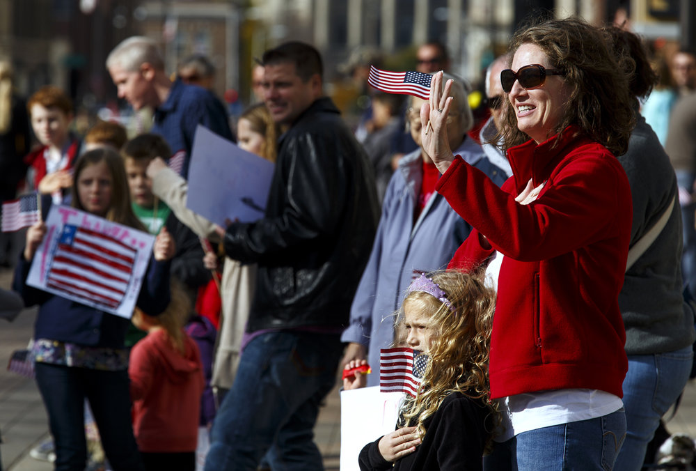 Amanda Moore and her daughter Milla, 5, watch as the Veterans Day parade passes on Capitol Avenue Friday, Nov. 11, 2016. Rich Saal/The State Journal-Register