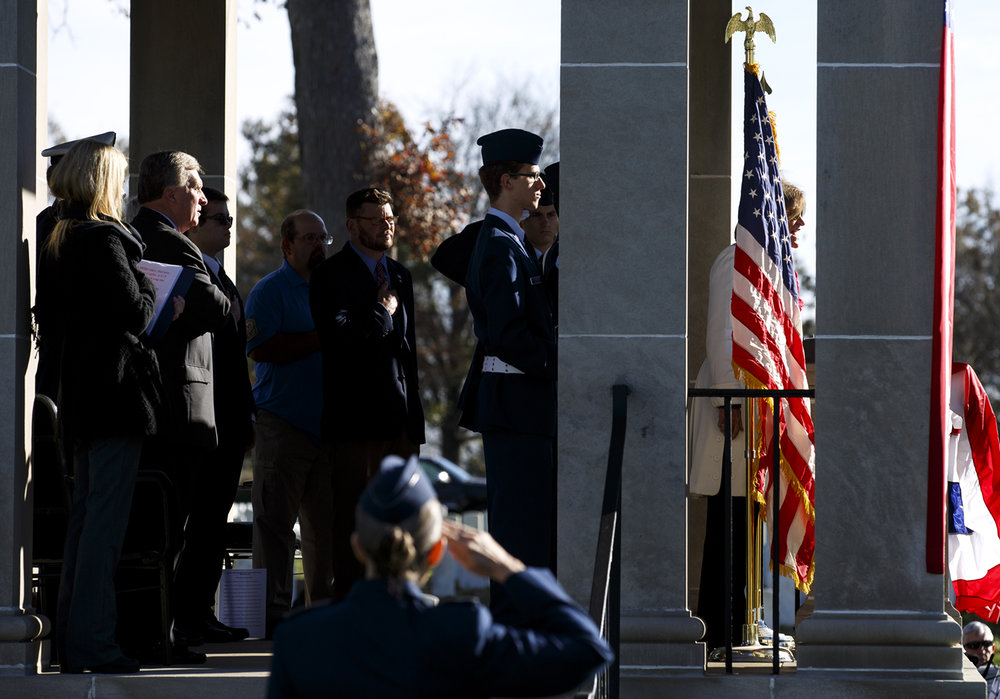 Deanna Cagley, U.S. Army veteran, right, sings the National Anthem at the beginning of the Veterans Day ceremony at Camp Butler National Cemetery Friday, Nov. 11, 2016. Rich Saal/The State Journal-Register
