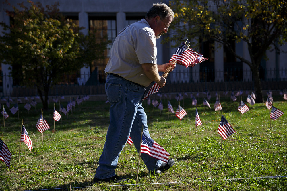 Larry Sturm helps install the Hallowed Ground flag display on the lawn of the Old State Capitol in Springfield, Ill. Thursday, Nov. 10, 2016. The display honors military veterans and includes 3,512 flags, one for each of the marked Union Civil War graves at Gettysburg National Cemetery in Pennsylvania. It will stay up through next week, until the 153rd anniversary of President Abraham Lincoln's Gettysburg Address on Nov.19. Sturm is an employee of the Illinois Historic Preservation Agency. Rich Saal/The State Journal-Register