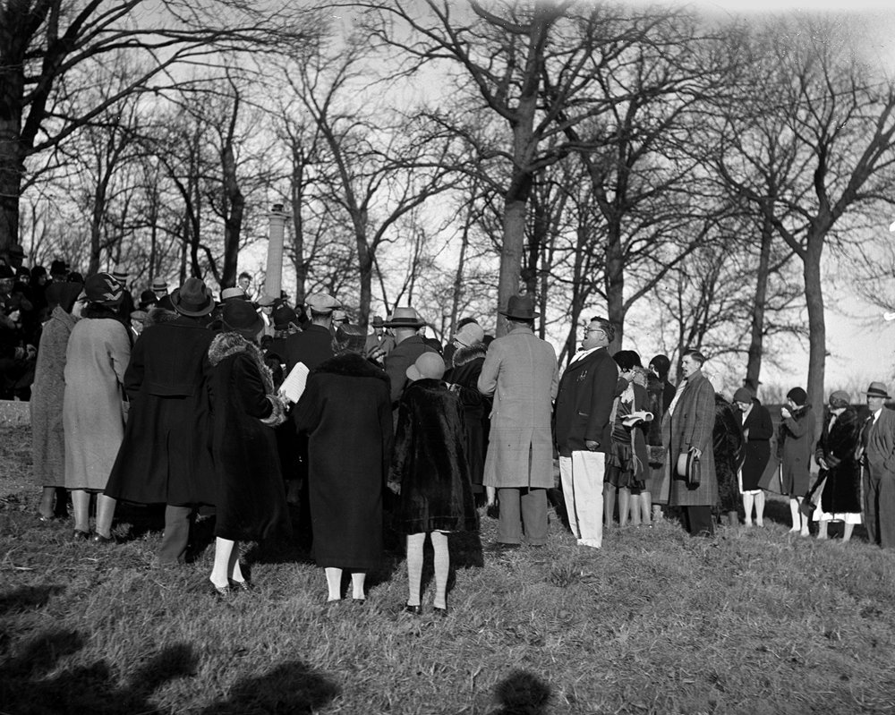 "Evangelist Roy ""Frosty"" Foster; in white pants; leads people in a song during a service at Bunn Park Nov. 24; 1930. Foster baptized seven adults that day in the lagoon at the park. File/The State Journal-Register"