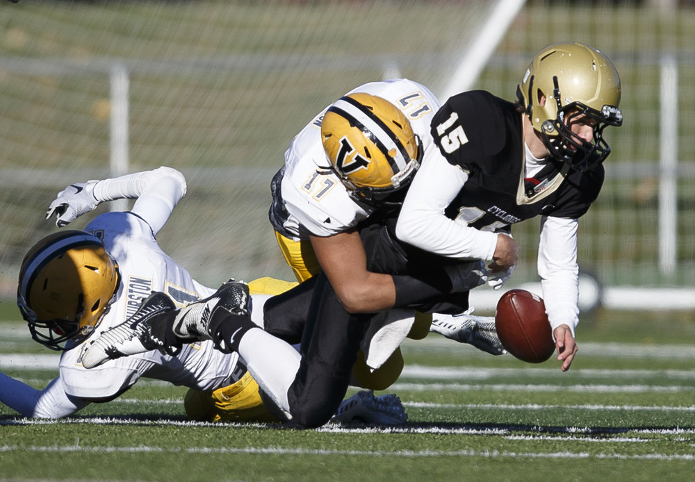 Burbank St. Laurence's Edward Pierson (17) strips the ball away from Sacred Heart-Griffin quarterback Tim Brenneisen (15) forcing a fumble in the first half during the IHSA Class 6A semifinals at the SHG Sports Complex, Saturday, Nov. 19, 2016, in Springfield, Ill. Justin L. Fowler/The State Journal-Register