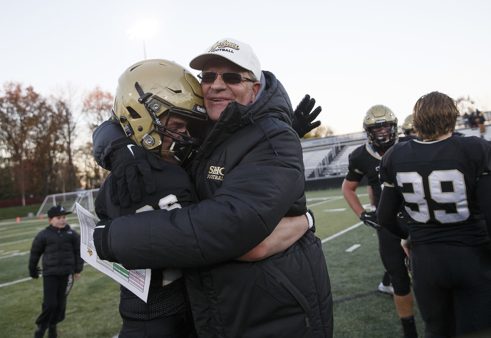 Sacred Heart-Griffin head football coach Ken Leonard celebrates with Sacred Heart-Griffin's Nick Friedmeyer (26) after the Cyclones defeated Burbank St. Laurence 28-16 in the IHSA Class 6A semifinals at the SHG Sports Complex, Saturday, Nov. 19, 2016, in Springfield, Ill. Justin L. Fowler/The State Journal-Register