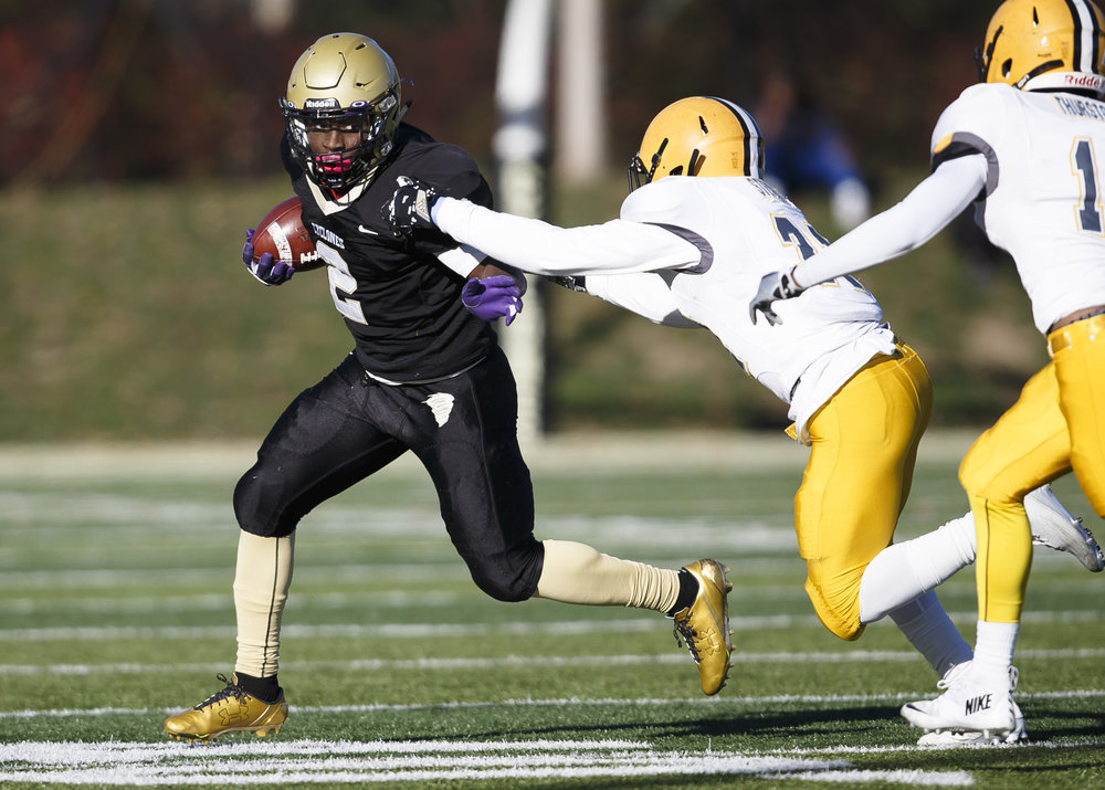 Sacred Heart-Griffin's Tremayne Lee (2) tries to put a stiff arm on Burbank St. Laurence's Isaiah Morrison (21) on a rush In the first half during the IHSA Class 6A semifinals at the SHG Sports Complex, Saturday, Nov. 19, 2016, in Springfield, Ill. Justin L. Fowler/The State Journal-Register