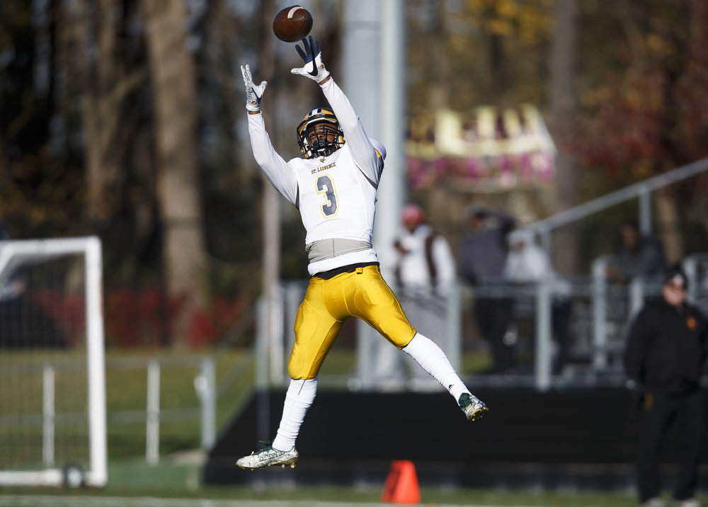 Burbank St. Laurence's Levy Hamer (3) makes a leaping catch wide open in the middle of the field against Sacred Hear-Griffin in the first half during the IHSA Class 6A semifinals at the SHG Sports Complex, Saturday, Nov. 19, 2016, in Springfield, Ill. Justin L. Fowler/The State Journal-Register