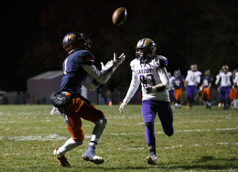 Rochester's D'Ante Cox (1) hauls in a pass against Canton's Preston Taylor in the first half during the IHSA Class 4A semifinals at the Rocket Booster Stadium, Saturday, Nov. 19, 2016, in Rochester, Ill. Justin L. Fowler/The State Journal-Register