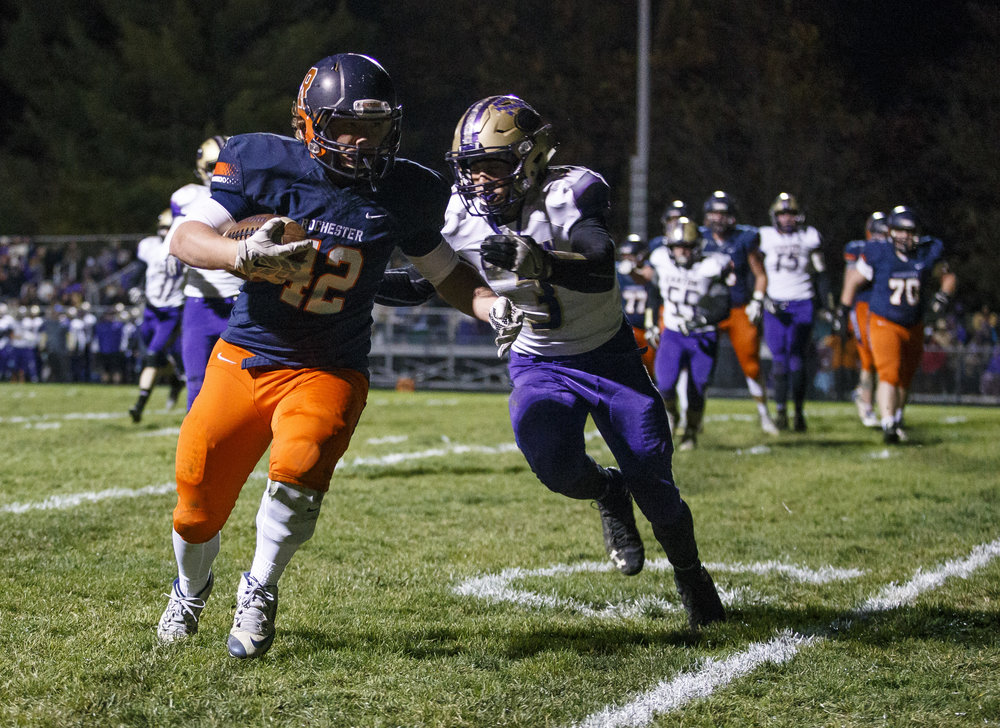 Rochester's Sam Baker (42) goes in for a touchdown against Canton's Evan Otto (3) in the first half during the IHSA Class 4A semifinals at the Rocket Booster Stadium, Saturday, Nov. 19, 2016, in Rochester, Ill. Justin L. Fowler/The State Journal-Register