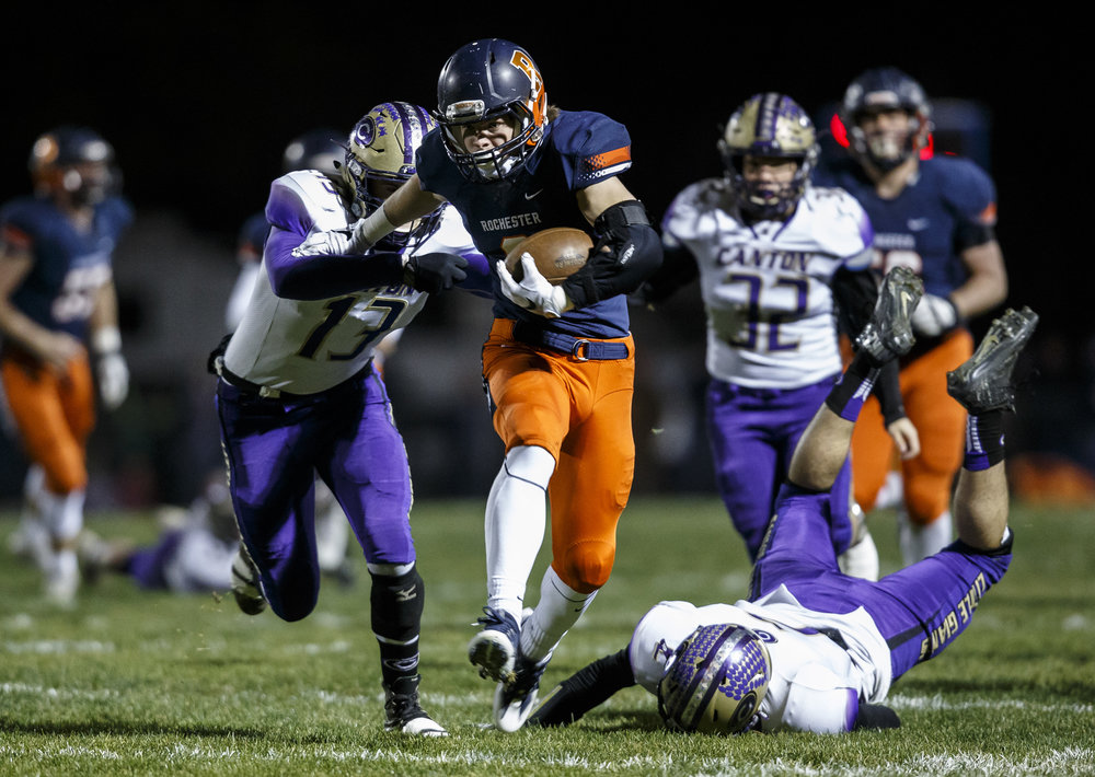 Rochester's Matt Wike (2) puts a stiff arm on Canton's Cameron Lucas (13) on his way to a touchdown in the first half during the IHSA Class 4A semifinals at the Rocket Booster Stadium, Saturday, Nov. 19, 2016, in Rochester, Ill. Justin L. Fowler/The State Journal-Register