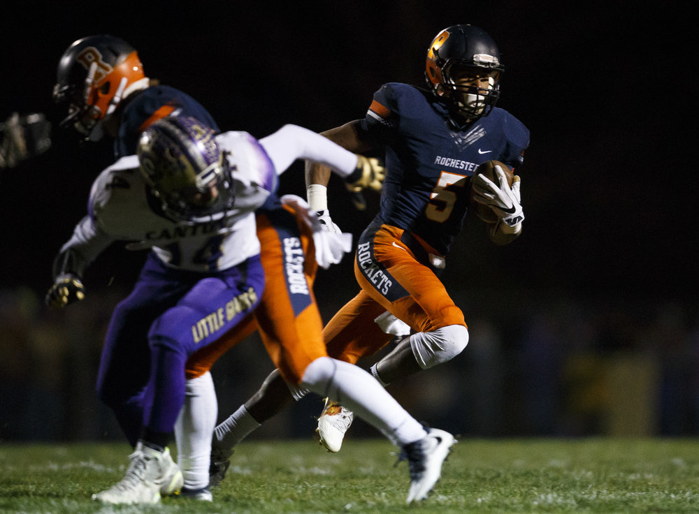 Rochester's Avante' Cox (5) gets outside of the Canton defense on a rush in the first half during the IHSA Class 4A semifinals at the Rocket Booster Stadium, Saturday, Nov. 19, 2016, in Rochester, Ill. Justin L. Fowler/The State Journal-Register