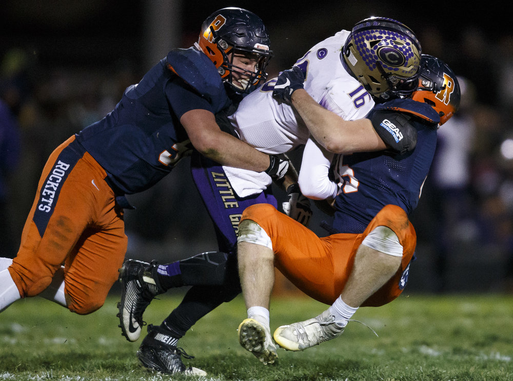 Canton quarterback Clint Wells (16) is sacked by Rochester's Austin Mathis (56) and Rochester's Mike McNicholas (85) in the first half during the IHSA Class 4A semifinals at the Rocket Booster Stadium, Saturday, Nov. 19, 2016, in Rochester, Ill. Justin L. Fowler/The State Journal-Register