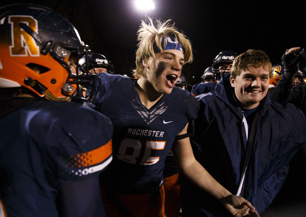 Rochester's Mike McNicholas (85) celebrates with the team after the Rockets defeated Canton 49-21 in the IHSA Class 4A semifinals at the Rocket Booster Stadium, Saturday, Nov. 19, 2016, in Rochester, Ill. Justin L. Fowler/The State Journal-Register