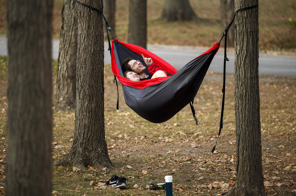 "Jeremy Lewis and Jillian Mulvany look towards the treetops while enjoying the record setting warm weather for November from a hammock inside Washington Park, Thursday, Nov. 17, 2016, in Springfield, Ill. ""We're not the biggest fan of the warm weather (for this time of year) so we're taking advantage of it,"" said Mulvany of the record setting high temperature of 79 degrees in Springfield that broke the record of 75 set in 1958. Justin L. Fowler/The State Journal-Register"