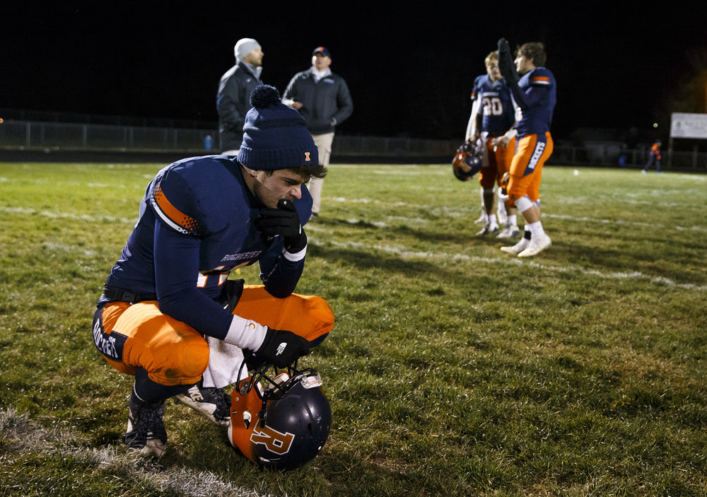 Rochester quarterback Josh Grant (14) pauses on the field after the Rockets defeated Canton 49-21 in the IHSA Class 4A semifinals at the Rocket Booster Stadium, Saturday, Nov. 19, 2016, in Rochester, Ill. Justin L. Fowler/The State Journal-Register