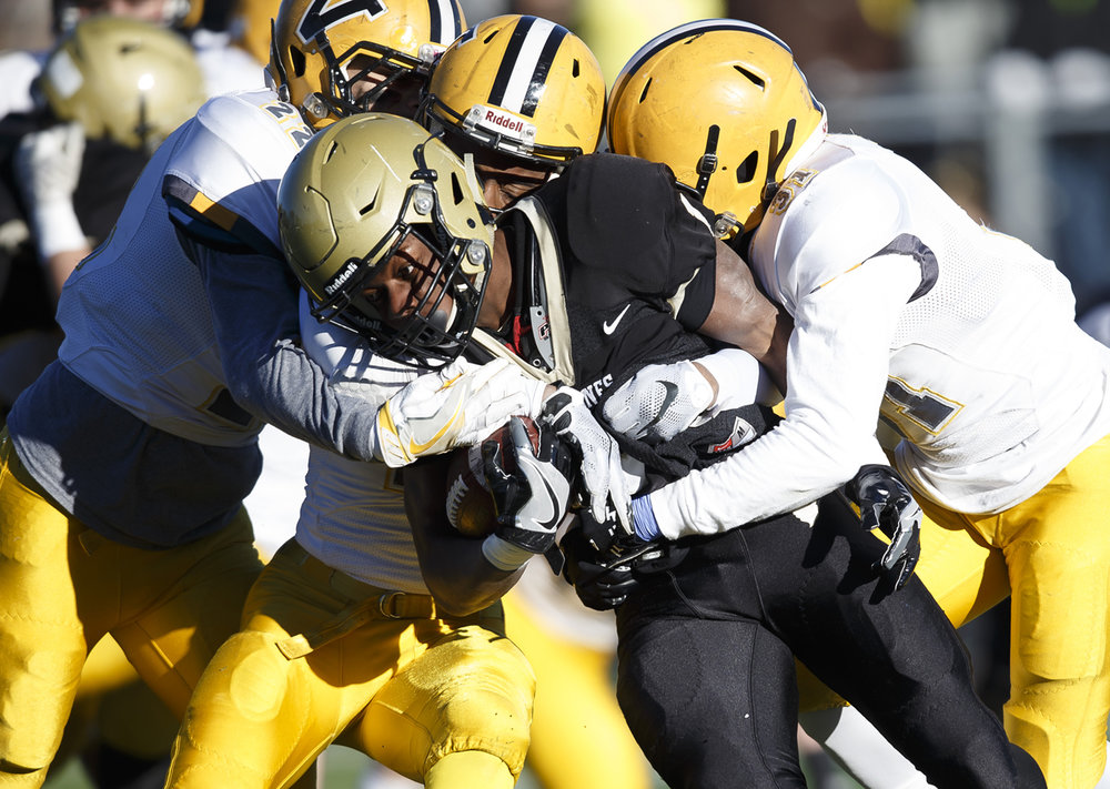 Sacred Heart-Griffin's Brain Adams (1) is gang tackled by Burbank St. Laurence on a rush In the first half during the IHSA Class 6A semifinals at the SHG Sports Complex, Saturday, Nov. 19, 2016, in Springfield, Ill. Justin L. Fowler/The State Journal-Register