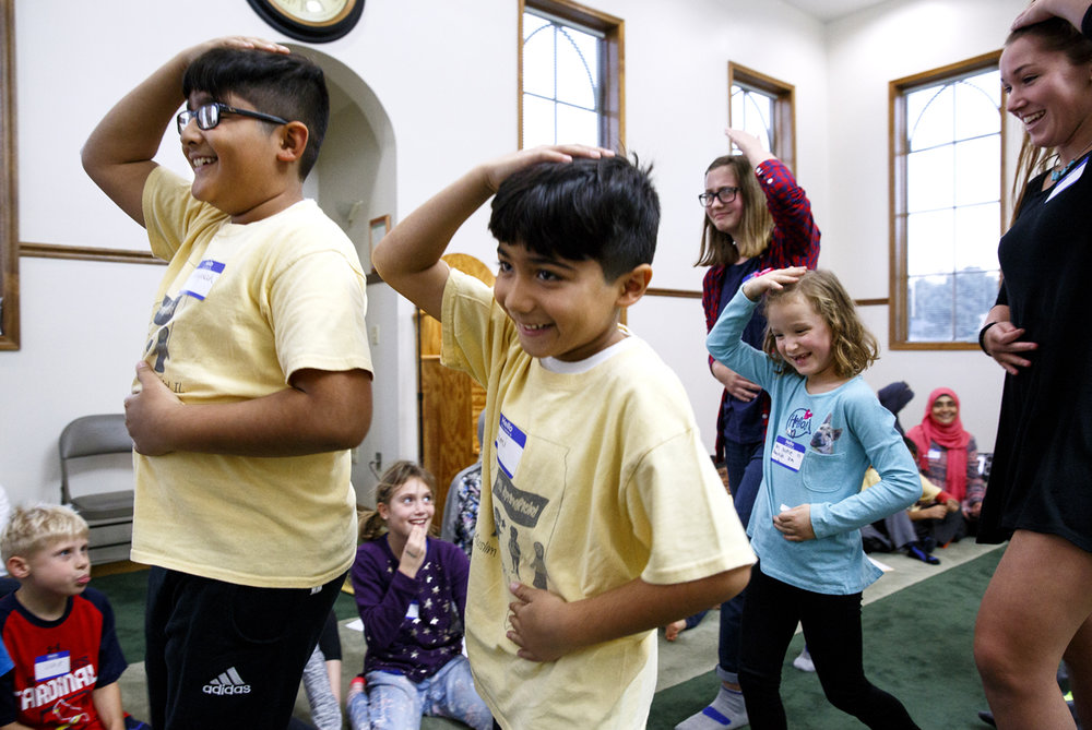 Children of Abraham, a program that brings together kids from different faiths to build bridges and foster friendships at a young age, gets started with a game for everyone at the Islamic Society of Greater Springfield mosque Wednesday, Nov. 16, 2016. Brothers Ubaydah, left, and Sulaymaan Mahmood lead a group in the fun. Rich Saal/The State Journal-Register