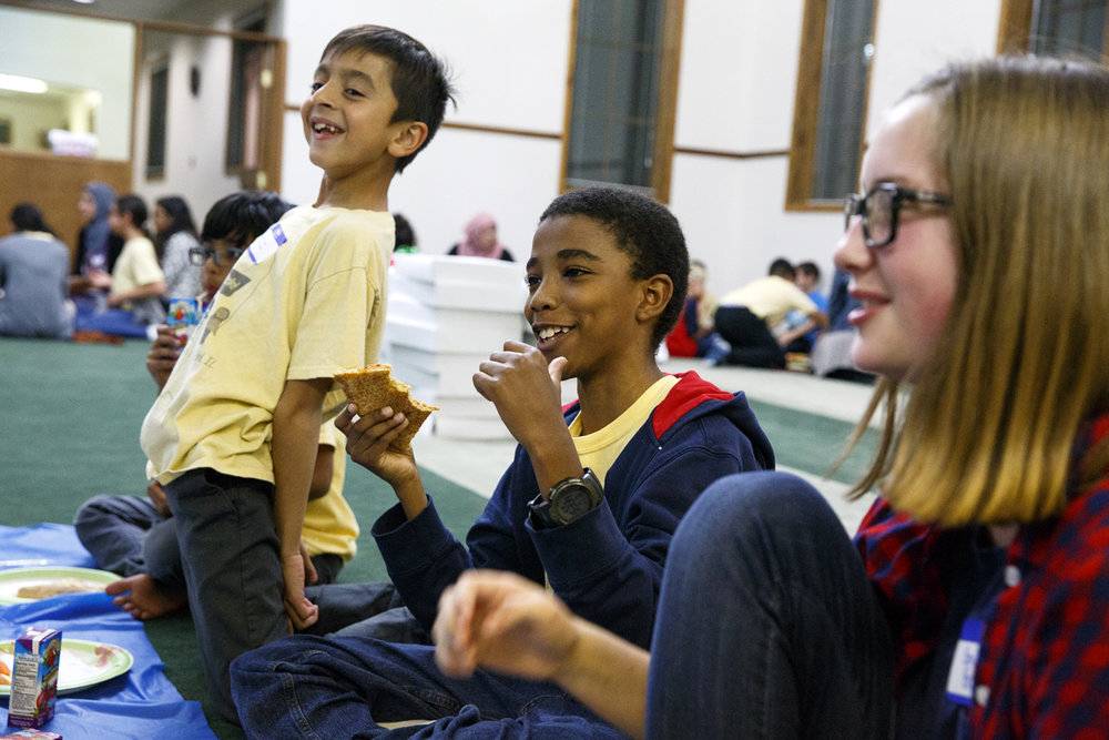Faiz Qureshi, left, Ahmed Rashid and Emily Brower enjoy dinner and laughs together during the Children of Abraham program at the Islamic Society of Greater Springfield mosque Wednesday, Nov. 16, 2016. The gatherings bring together kids from different faiths to build bridges and friendships at a young age. Rich Saal/The State Journal-Register