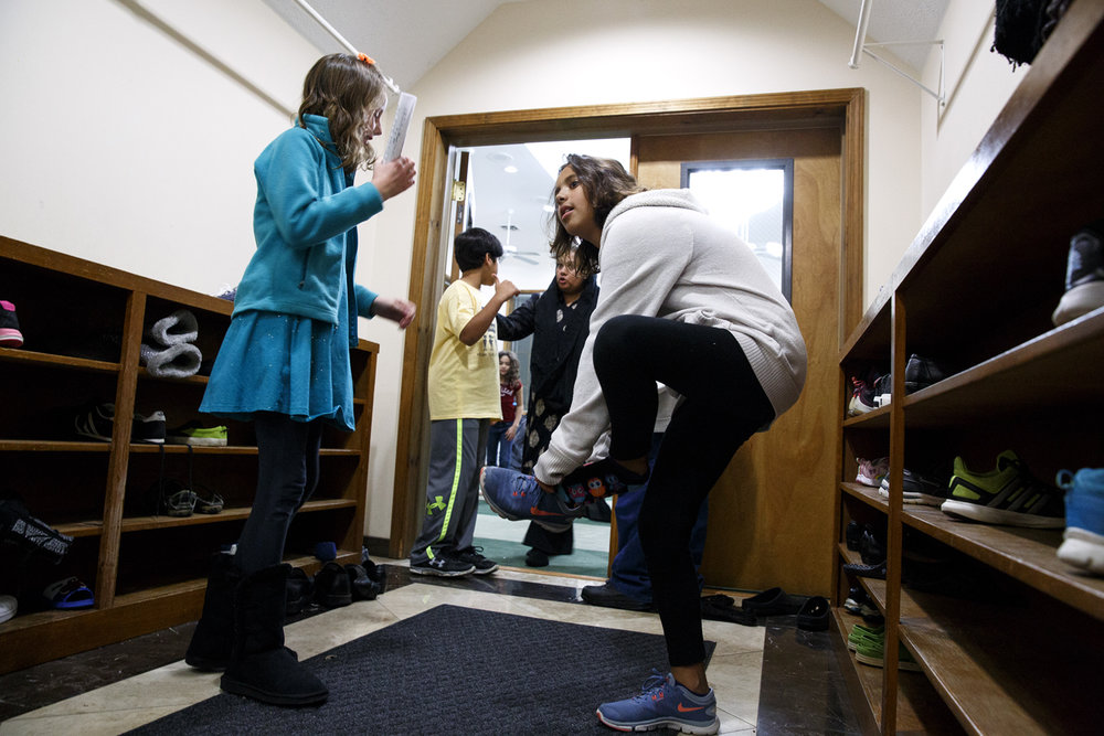 Norah Oberholtzer puts her shoes back on after the Children of Abraham program at the Islamic Society of Greater Springfield mosque Wednesday, Nov. 16, 2016. The gatherings bring together kids from different faiths to build bridges and friendships at a young age. Rich Saal/The State Journal-Register
