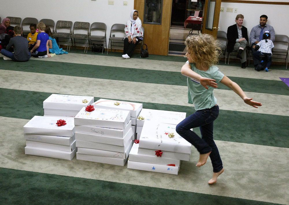 Avery Musick delights in the pile of care packages made for patients at HSHS St. John's Children's Hospital, one of the activities during the Children of Abraham program at the Islamic Society of Greater Springfield mosque Wednesday, Nov. 16, 2016. The gatherings bring together kids from different faiths to build bridges and friendships at a young age. Rich Saal/The State Journal-Register