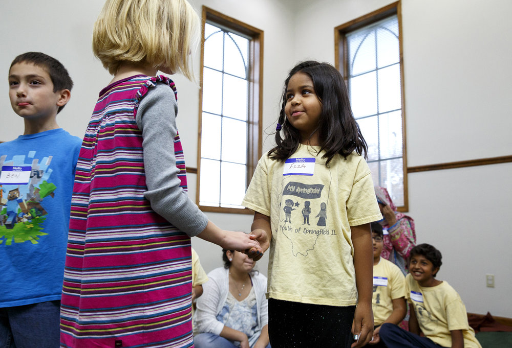 Fiza Shaikh, right, introduces herself to Ruby Klein during the Children of Abraham program at the Islamic Society of Greater Springfield mosque Wednesday, Nov. 16, 2016. The gatherings bring together kids from different faiths to build bridges and friendships at a young age. Shaikh's family are members of the mosque and Klein's are members of Westminster Presbyterian Church. Rich Saal/The State Journal-Register