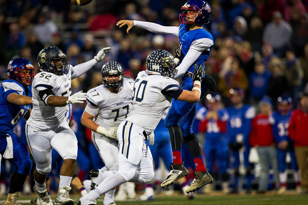 Carlinville's quarterback Adam Walton is pressured by Elmhurst's Jimmy Kenneally as he releases a pass during the Class 3A championship game at Memorial Stadium in Champaign, Ill., Friday, Nov. 25, 2016. Ted Schurter/The State Journal-Register