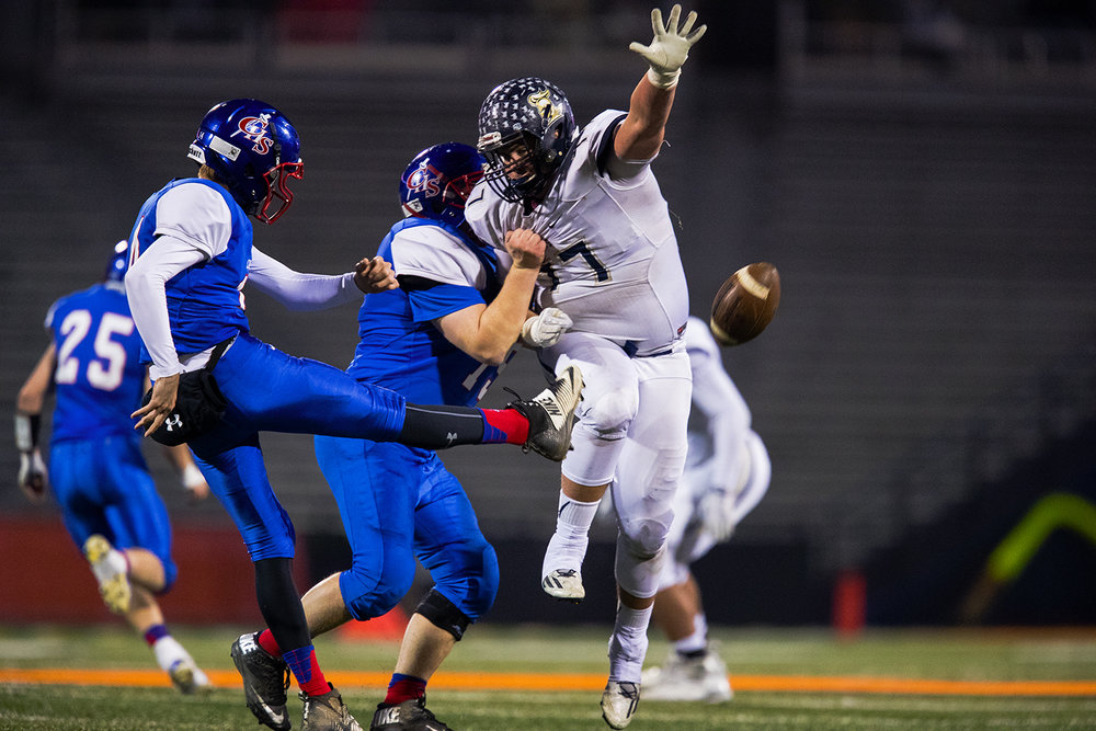 Elmhurst's Jordan Rowell (77) attempts to block a punt by Carlinville's Adam Walton during the Class 3A championship game at Memorial Stadium in Champaign, Ill., Friday, Nov. 25, 2016. Ted Schurter/The State Journal-Register
