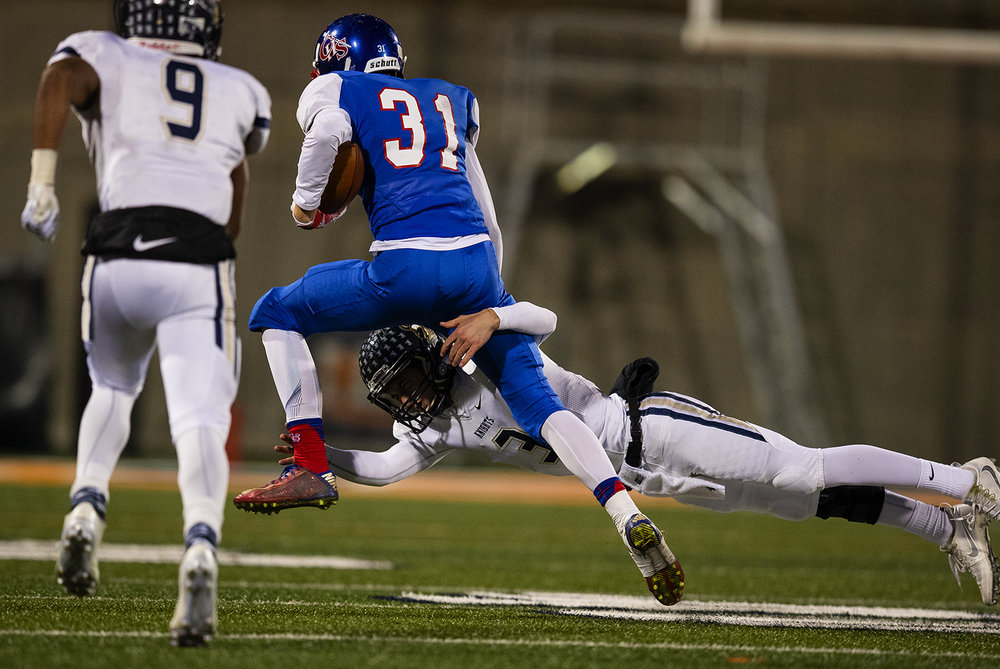 Elmhurst's Luke Ricobene dives for Carlinville's Kyle Dixon after he snared an interception during the Class 3A championship game at Memorial Stadium in Champaign, Ill., Friday, Nov. 25, 2016. Ted Schurter/The State Journal-Register