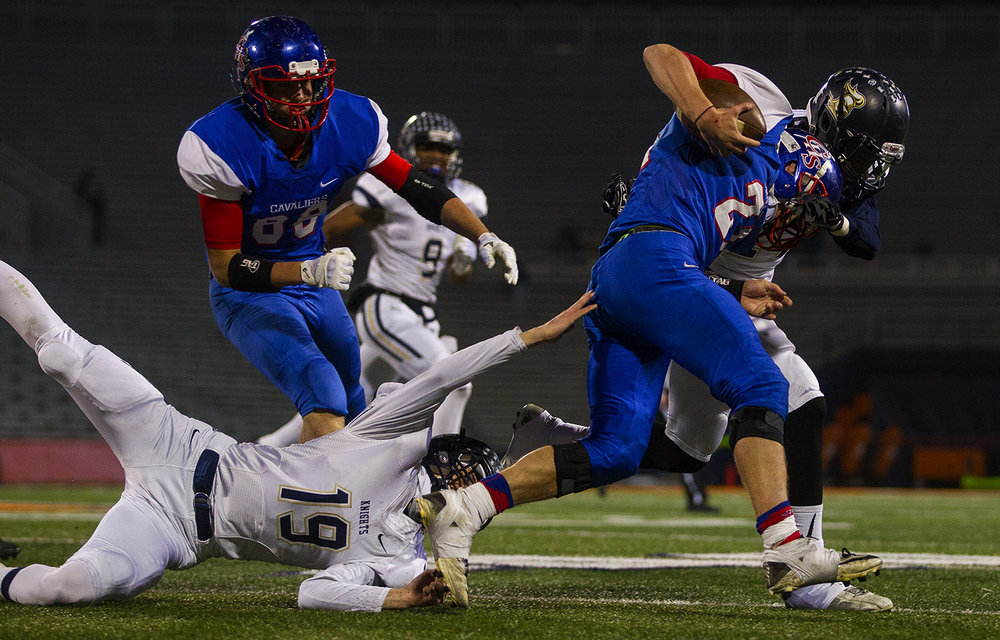 Elmhurst's James Lytton dives for Carlinville's Jacob Dixon during the Class 3A championship game at Memorial Stadium in Champaign, Ill., Friday, Nov. 25, 2016. Ted Schurter/The State Journal-Register