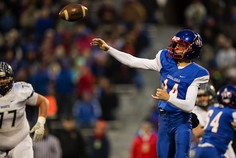 Carlinville's Adam Walton fires a pass against Elmhurst during the Class 3A championship game at Memorial Stadium in Champaign, Ill., Friday, Nov. 25, 2016. Ted Schurter/The State Journal-Register