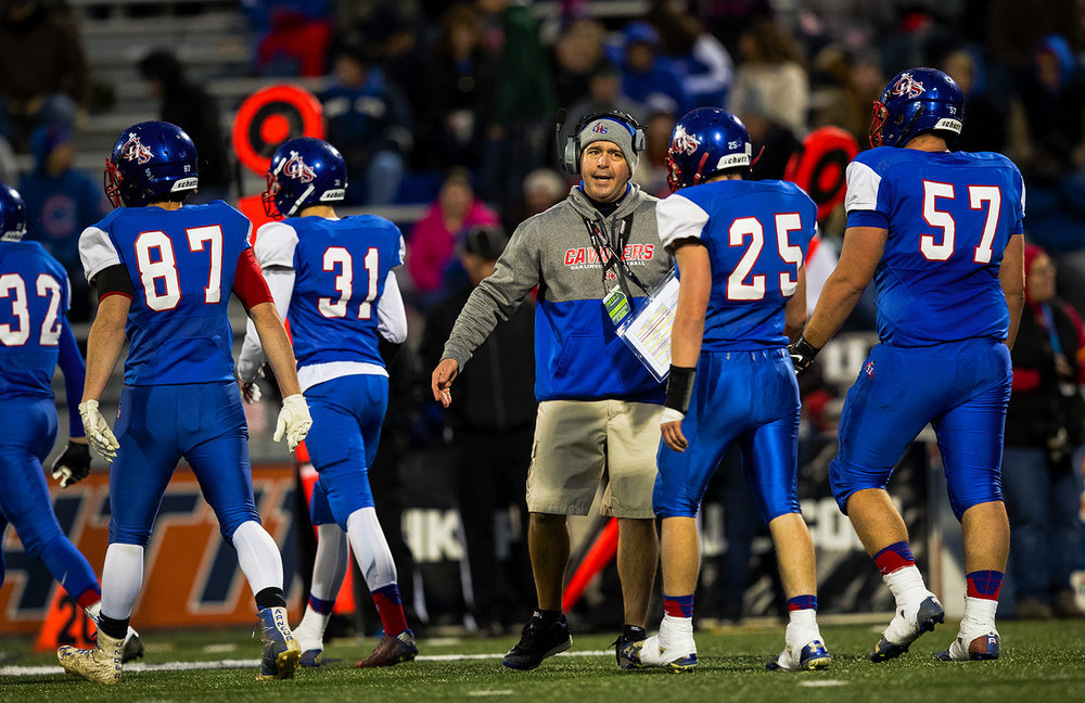 Carlinville head coach Chad Easterday talks to his team as they come off the field after Elmhurst's second touchdown in the opening minutes of the Class 3A championship game at Memorial Stadium in Champaign, Ill., Friday, Nov. 25, 2016. Ted Schurter/The State Journal-Register