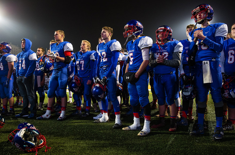 The Carlinville Cavaliers watch as their captains receive their second place trophy after losing to Elmhurst during the Class 3A championship game at Memorial Stadium in Champaign, Ill., Friday, Nov. 25, 2016. Ted Schurter/The State Journal-Register