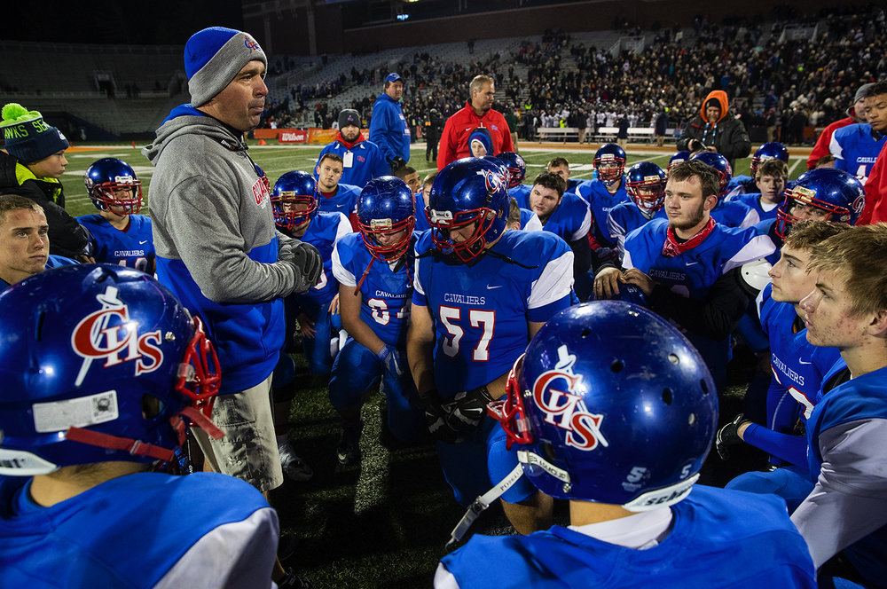 Carlinville head coach Chad Easterday talks to his team on the field after they lost to Elmhurst during the Class 3A championship game at Memorial Stadium in Champaign, Ill., Friday, Nov. 25, 2016. Ted Schurter/The State Journal-Register