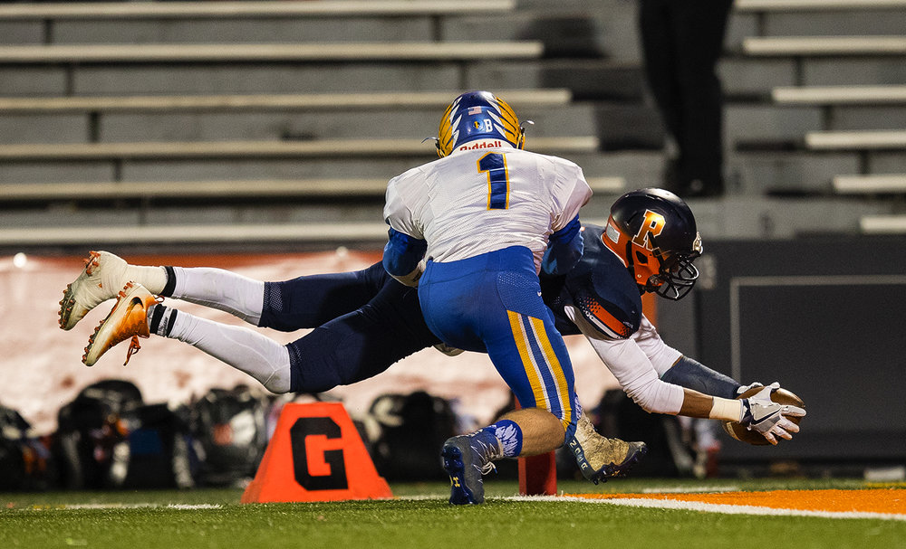 Rochester's D'Ante Cox dives into the endzone in front of Johnsburg's Blake Lemke during the Class 4A championship game at Memorial Stadium in Champaign, Ill., Friday, Nov. 25, 2016.  Ted Schurter/The State Journal-Register