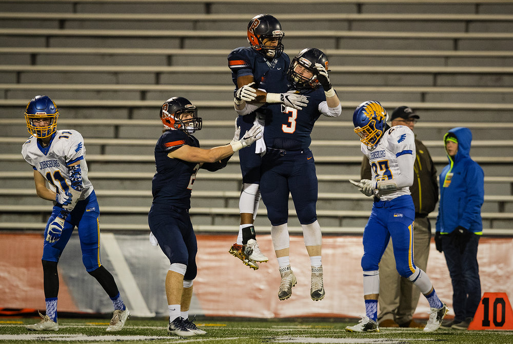 Rochester's Avante' Cox, center, celebrates with teammates Matt Wike, left, and Jeff Thomas after he scored a first half touchdown during the Class 4A championship game at Memorial Stadium in Champaign, Ill., Friday, Nov. 25, 2016. Ted Schurter/The State Journal-Register