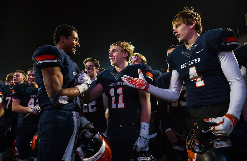 Rochester's Avante' Cox (5) celebrates with Skylor Caruso (11) after the Rockets defeated Johnsburg during the Class 4A championship game at Memorial Stadium in Champaign, Ill., Friday, Nov. 25, 2016.  Ted Schurter/The State Journal-Register