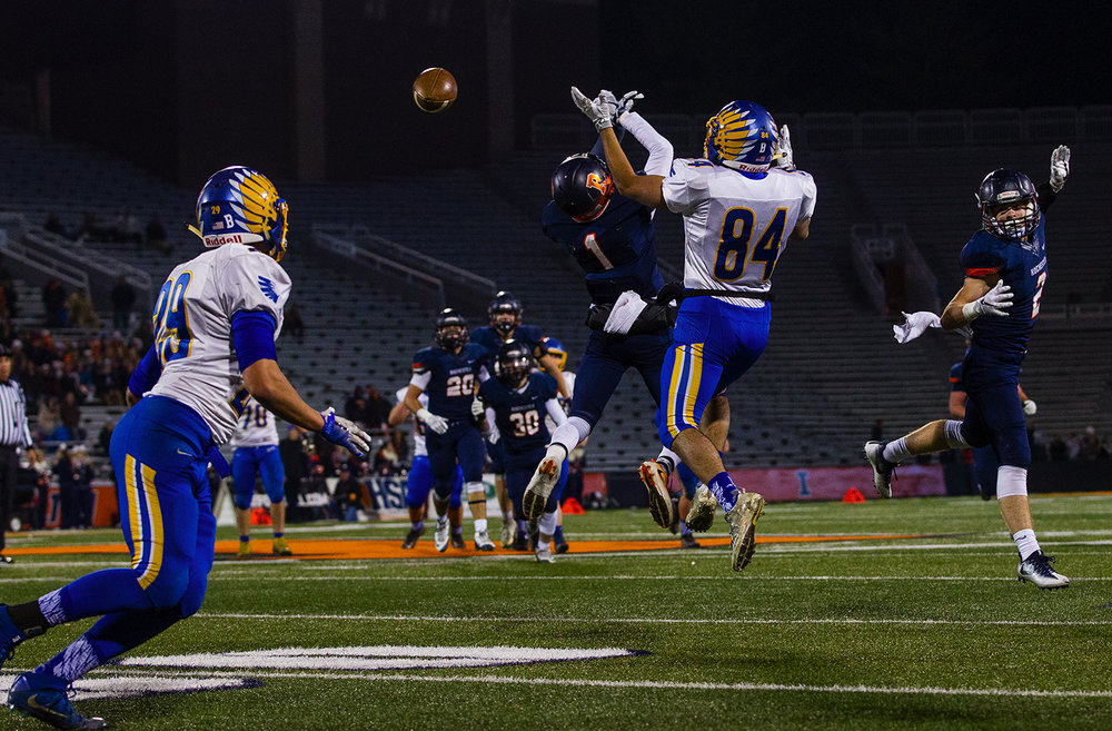 Rochester's D'Ante Cox tips a pass near the end zone intended for Johnsburg's Nico LoDolce that was caught by his brother Avante' Cox during the Class 4A championship game at Memorial Stadium in Champaign, Ill., Friday, Nov. 25, 2016.  Ted Schurter/The State Journal-Register