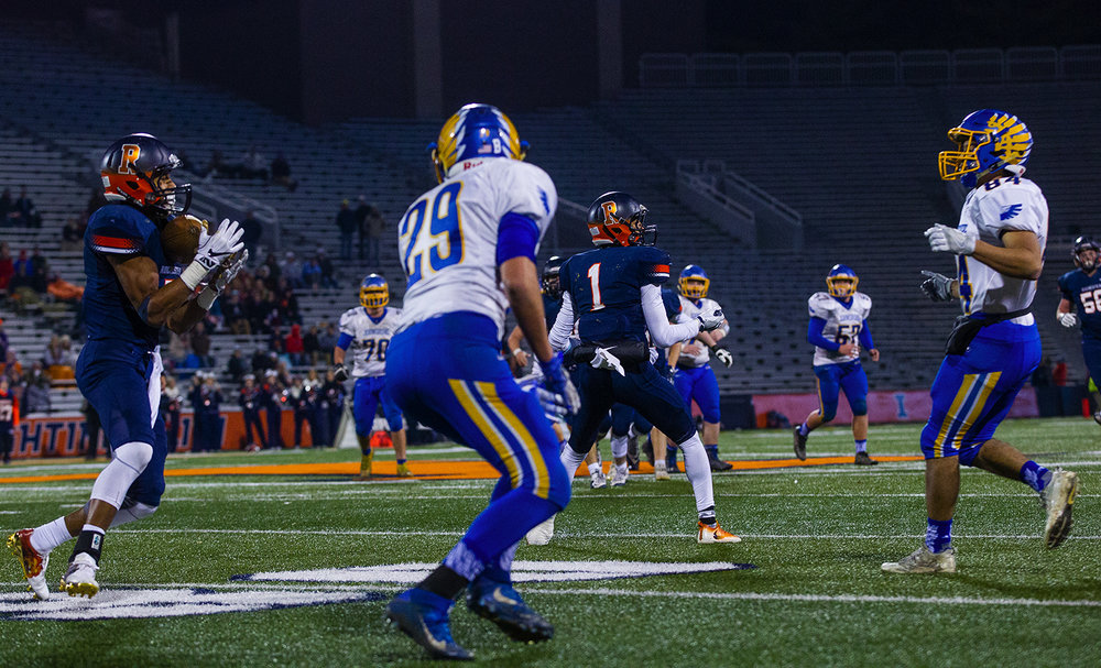 Rochester's Avante' grabs an interception near the end zone intended for Johnsburg's Nico LoDolce that was tipped by his brother D'Ante Cox during the Class 4A championship game at Memorial Stadium in Champaign, Ill., Friday, Nov. 25, 2016.  Ted Schurter/The State Journal-Register