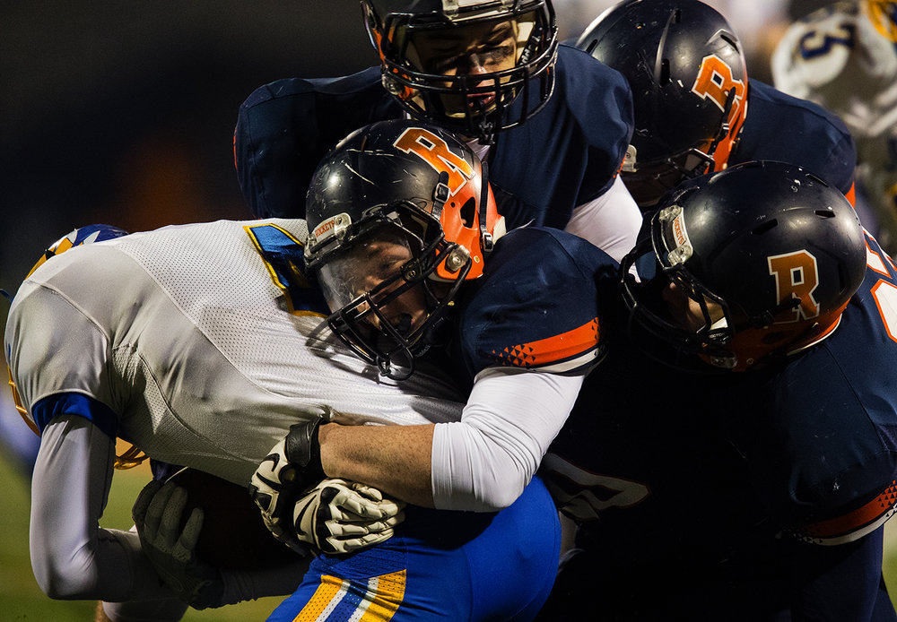 A trio of Rochester defenders bring down Johnsburg's Jarred Bergren during the Class 4A championship game at Memorial Stadium in Champaign, Ill., Friday, Nov. 25, 2016.  Ted Schurter/The State Journal-Register